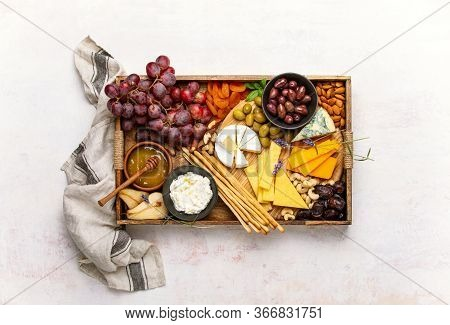 Cheeseboard Overhead View, Cheese Assortment Served With Honey, Grapes Nuts And Olives, Healthy Food