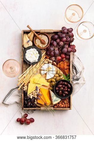 Tray With Cheese Assortment Served With Rose Wine For A Light Summer Snack, Top Downview