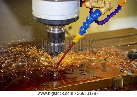 The Cnc Milling Machine Cutting The Tire Mold Parts With Liquid Oil Coolant Method. The Mold And Die