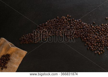 Coffee Beans On Rustic Slate Background Conzept