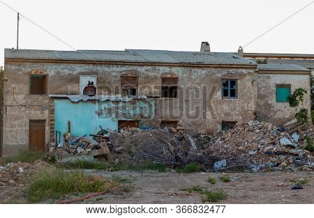 Collapsed House Full Of Rubble The City