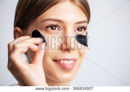 Eye Patch, Beautiful Woman With Natural Makeup And Black Hydro Gel Eye Patches On Facial Skin