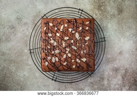Homemade Brownie With Chocolate And Almond Petals. Top View. Copy Space. Horizontal Orientation