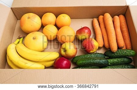 Donation Cardboard Box With Fruits And Vegetables.