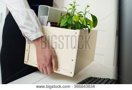 Businesswoman Holding Cardboard Box With Office Stuff. Resignation Concept.