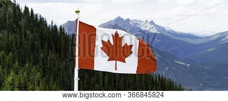 Canadian Flag Flying In A National Park In Alberta