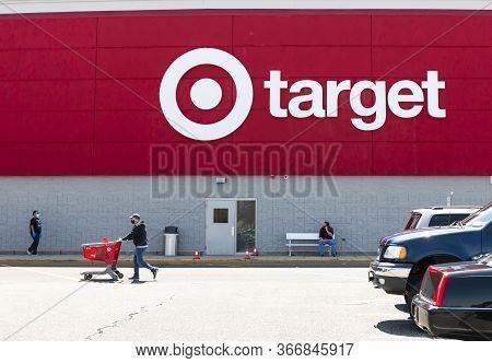 Bay Shore, New York, Usa - 25 April 2020: The Logo Of A Target Store On The Buildings Exterior Facin