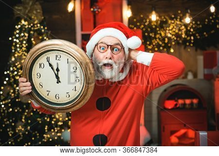 Santa Claus Holding Clock With Countdown To Christmas Or New Year Santa Claus In Wooden Home Interio