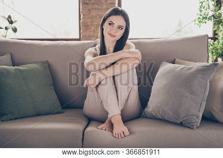 Full Body Photo Of Brown Hair Minded Interested Curious Girl Sit Divan Hugging Knees Look Imagine Fu