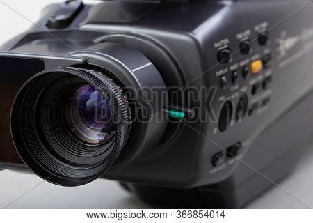 The video camera with the microphone isolated on white, in concept of technology, entertainment. Retro camcorder
