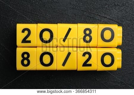 Yellow Blocks With Numbers 20 And 80 On Black Stone Background, Flat Lay. Pareto Principle Concept