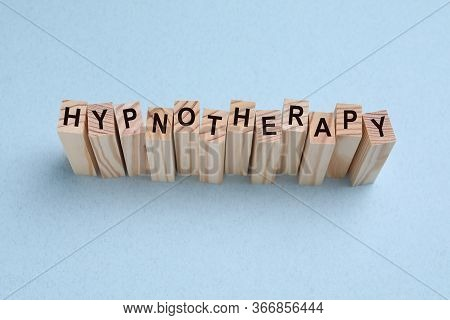 Wooden Blocks With Word Hypnotherapy On White Background, Above View