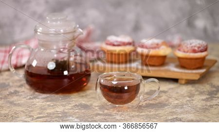 A Cup Of Tea With Roses Buns, Sweet Buns With Sugar Powder.