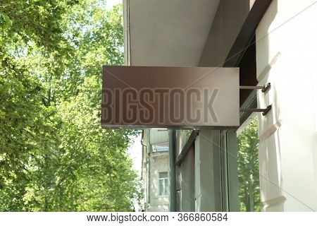Blank Lightbox Signage On Building Wall Outdoors. Advertising Board Design