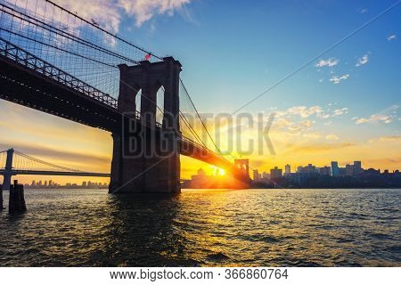 View on Brooklyn bridge and Brooklin at vibrant sunrise, New York City