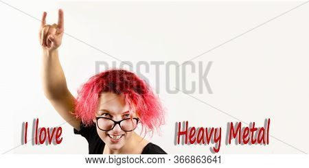 A Girl Rocker With Red Hair Shows A Hand Gesture Heavy Metal Hm On A White Background, The Inscripti