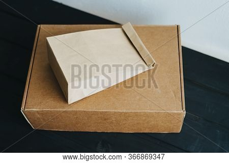 Box And Package Of Recycled Materials. Environmentally Friendly Packaging Material. Delivery To The