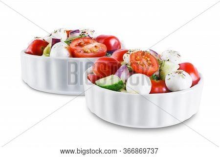 Tomato Cucumber Red Onion Mozzarella Salad On A White Isolated Background
