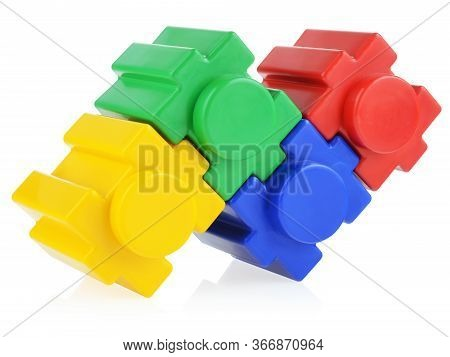 Childrens Construction Kit Assembled On A White Background. Concept Of Construction And Integration.
