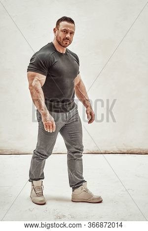 Athletic Man Isolated On A White Background, Wearing Casual Clothes And Showing His Embossed Body, L