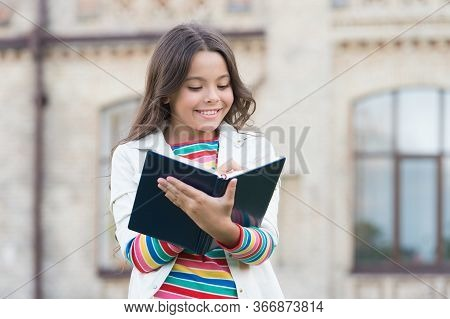 Access To Much More Than Just Book. Knowledge Concept. Little Girl Hold Book. Girl With Book School
