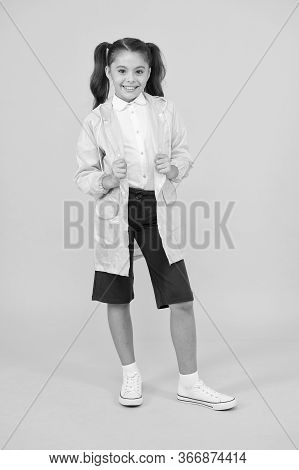 Happy Schoolgirl Wear Raincoat. Invest In Durable Kids Rainwear To Keep Children Out In Fresh Air. W