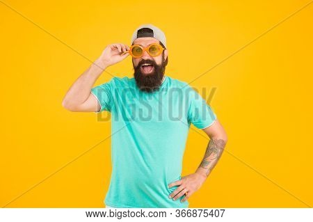 Hipster Wear Party Sunglasses. Eyes Health. Bearded Man In Sunglasses Orange Background. Eyesight Ch
