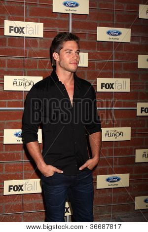 LOS ANGELES - SEP 10:  Dean Geyer arrives at the FOX Eco-Casino Party 2012 at Bookbindery on September 10, 2012 in Culver City, CA