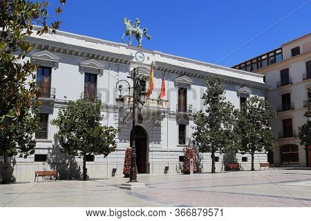 Granada, Spain - May 20, 2017: This Is The City Hall Building, Decorated With The Sculpture Exact Mo
