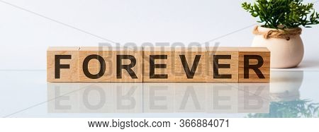 Forever Word Written On Wood Block. Forever Text On White Background, Concept.