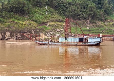 Huangqikou, Chongqing, China - May 8, 2010: Yangtze River. Inactive Light Blue Dredging Vessels Moor