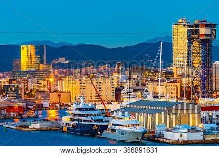 Barcelona, Spain - November 07 2018: Night City Skyline In Catalonia. Modern Architecture And Yachts