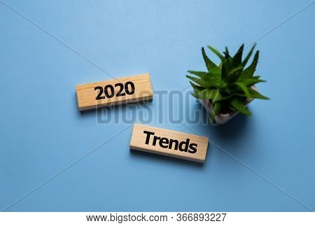 Wooden Blocks With The Word Trends 2020. Main Trend Of Changing Something. Popular And Relevant Topi