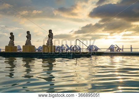 Koh Kho Khao, Thailand - November 5, 2012: Tropical pool scenery of the Andaman Princess Resort & SPA at sunset. This beautiful hotel was destroyed by tsunami in 2004 and rebuild.