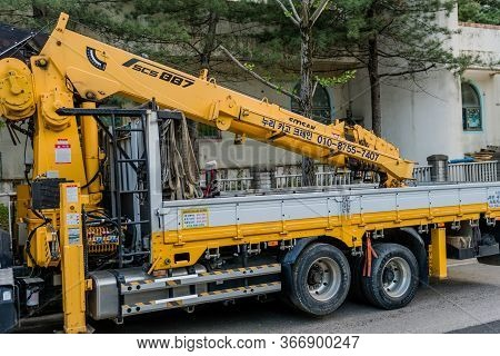 Daejeon, South Korea; May 12, 2020: Back Section Of Korean Truck Crane Parked On Side Of Residential