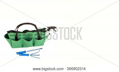 Isolated Green Handbag. Green Bag Multi Purpose With Pockets. Green Bag For Gardening With Tools. Co