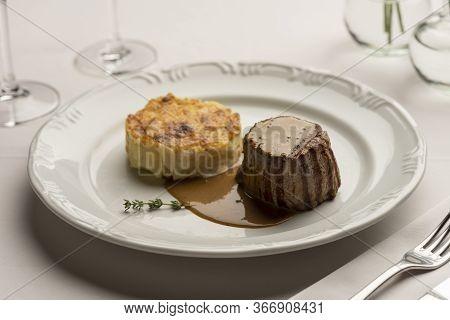 Fillet Mignon Tenderloin With Potatoes Gratin And Green Poivre Vert Sauce Gravy On White With Wine G