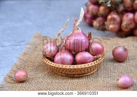 Thai Red Onion Or Shallots. Fresh Purple Shallots On Bamboo Basket With Old Wallpaper And Shallots B