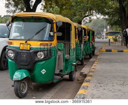 Delhi, India - March 14, 2019: Tuk Tuk Drivers Wait For Customers Outside A Metro Station In Delhi,
