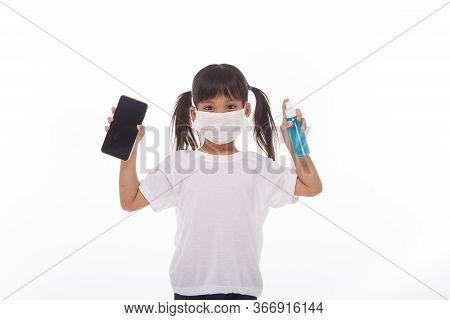 Asian Girl Wear Mask Cleaning Smartphone Screen With Alcohol.on White Background. Concept Of Cleanin