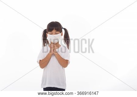 Asian Girl Wearing Mask For Protect Pm2.5 And Coronavirus Covid-19.stay At Home Praying To God.onlin