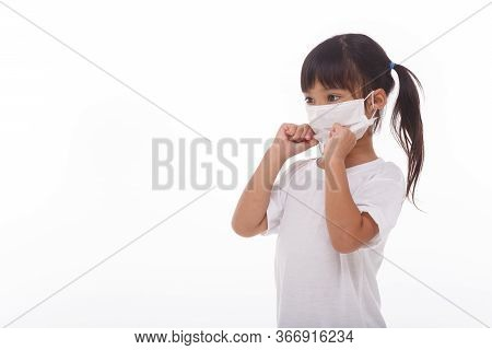 Asian Little Child Girl Wearing Respirator Mask To Protect Coronavirus Outbreak