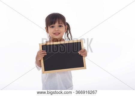 Little Asian Child Show The Black Board On Isolated Background