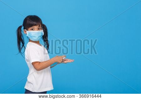 Cute Asian Girl Wearing A Mask And Washing Her Hands With Alcohol To Prevent Spreading The Disease O