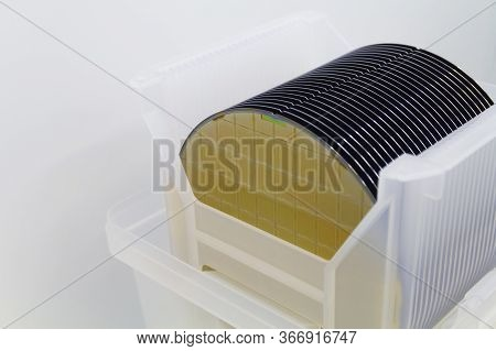 Close Up Of Silicon Wafers Gold Yellow Color With Chip Cells Prepared For Production In A Semiconduc