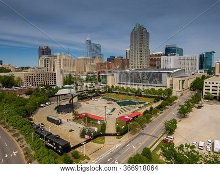April 23, 2020 - Raleigh, North Carolina, USA: Red Hat Amphitheater, situated in the heart of Downtown Raleigh, offers an immersive entertainment experience with stunning views of the Raleigh skyline.