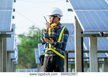 Solar Power Plant,engineer Working On Checking And Maintenance In Solar Power Plant On A Background