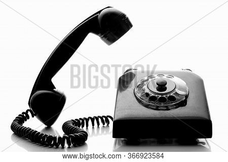 Vintage Black Landline Telephone With Handset Raised In Black And White. Retro Style Telephone With