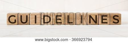 Wooden Cube With Word Guidelines On Light Background. Concept Image.