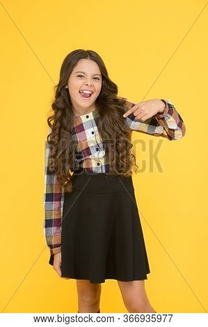 Essential Back To School Uniform Garment. Happy Child Pointing Finger. Little Girl In Formal Style.